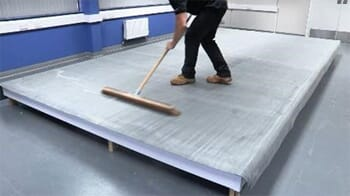 brushing down the membrane to remove trapped air