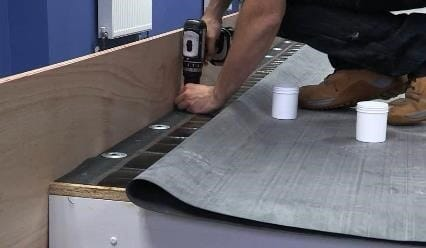 person applying the russ strip to epdm