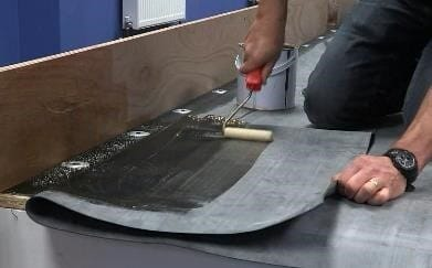 contact adhesive application to upstand