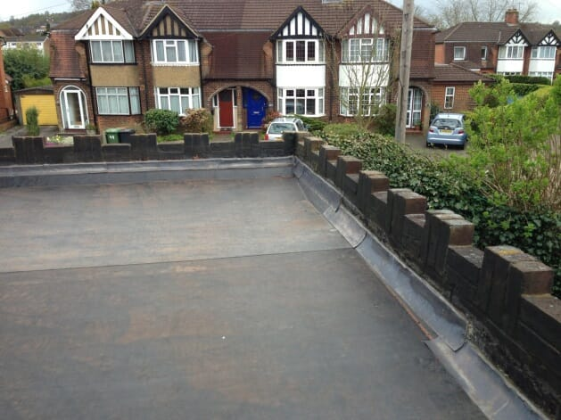 Parapet flat roof construction, repair and replacement with a DuoPly fleece-reinforced EPDM rubber flat roof